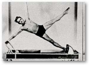 History of Pilates - Joseph using his Reformer